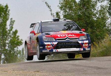 Loeb jumps his Citreon C4 rally car at WRC Rally Bulgaria.