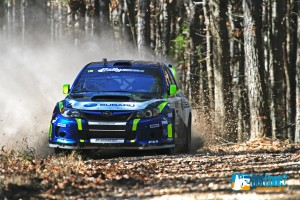 David Higgins tearing through the forest in his Subaru Rally Car
