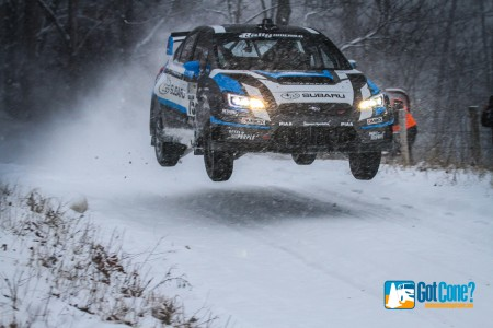 Subaru Rally Team USA driver David Higgins takes the jump at 2015 Rally in the 100 Acre Wood